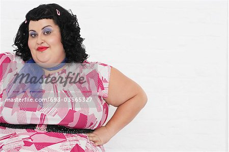 Overweight Woman posing with hands on hips, portrait Stock Photo - Premium Royalty-Free, Image code: 693-03565327