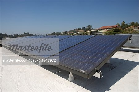 Solar array on rooftop in Los Angeles, California Stock Photo - Premium Royalty-Free, Image code: 693-03643972