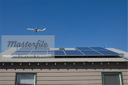 Aeroplane and rooftop with solar array, Inglewood, Los Angeles, California Stock Photo - Premium Royalty-Free, Image code: 693-03643977