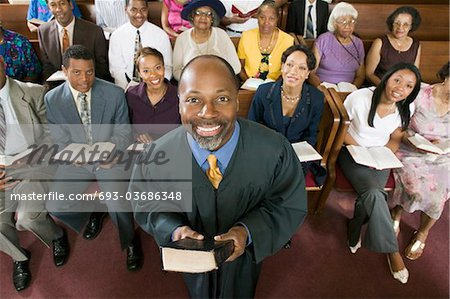 Preacher and Congregation, portrait, high angle view Stock Photo - Premium Royalty-Free, Image code: 693-03686348