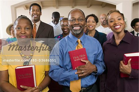 Sunday Service Congregation standing in church with Bibles, portrait Stock Photo - Premium Royalty-Free, Image code: 693-03686351