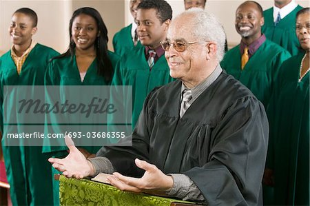 Minister Preaching in Front of Gospel Choir Stock Photo - Premium Royalty-Free, Image code: 693-03686355