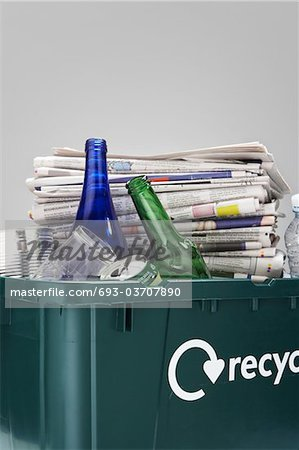 Full Recycling Container Stock Photo - Premium Royalty-Free, Image code: 693-03707890