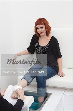 Foot masseuse and client in beauty salon Stock Photo - Premium Royalty-Free, Image code: 693-03782619