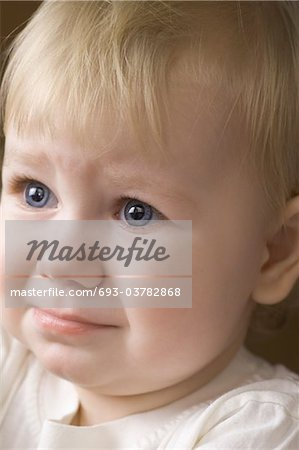 Blonde 14 month old on the verge of tears Stock Photo - Premium Royalty-Free, Image code: 693-03782868