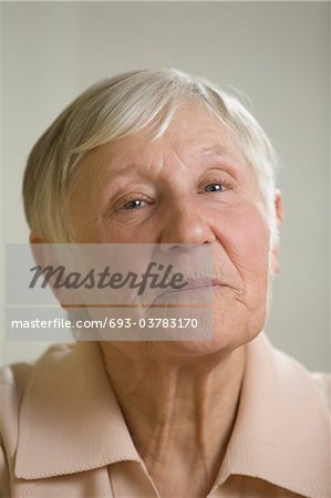 Portrait of elderly woman with short grey hair Stock Photo - Premium Royalty-Free, Image code: 693-03783170