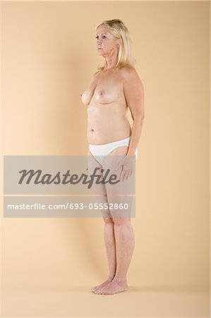 Full length of a woman standing topless Stock Photo - Premium Royalty-Free, Image code: 693-05552860