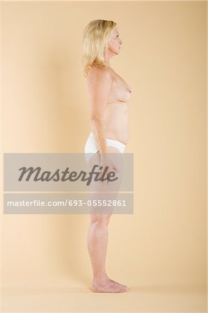 Side view of a woman showing her nude body Stock Photo - Premium Royalty-Free, Image code: 693-05552861