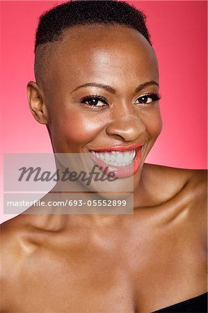 Portrait of cheerful African American woman Stock Photo - Premium Royalty-Free, Image code: 693-05552899