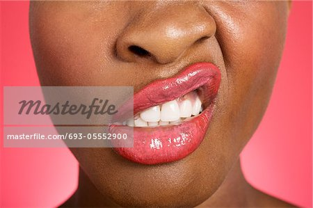 Close up of woman making a face Stock Photo - Premium Royalty-Free, Image code: 693-05552900