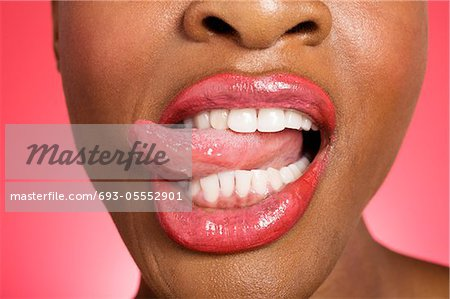 Close up of woman sticking out tongue Stock Photo - Premium Royalty-Free, Image code: 693-05552901
