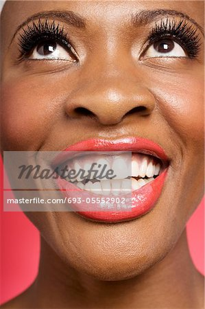 Close up of cheerful woman looking up Stock Photo - Premium Royalty-Free, Image code: 693-05552902
