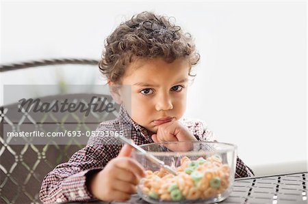 Grumpy child disappointed with his breakfast Stock Photo - Premium Royalty-Free, Image code: 693-05793965