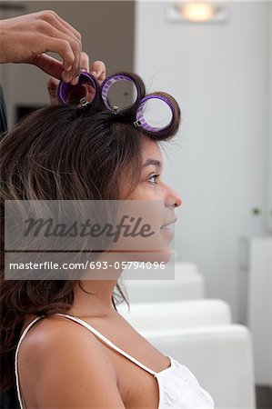 Side profile of young woman wearing curlers Stock Photo - Premium Royalty-Free, Image code: 693-05794096