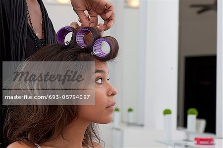 Young woman having hair curled in beauty salon Stock Photo - Premium Royalty-Free, Image code: 693-05794097