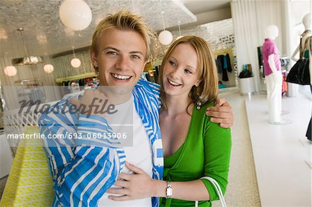 Young Couple Shopping in clothing store Together, portrait Stock Photo - Premium Royalty-Free, Image code: 693-06013906