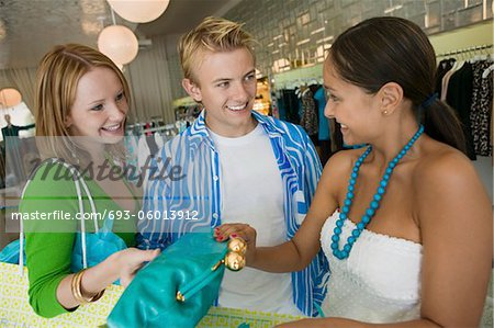 Friends Shopping at Clothing Store Stock Photo - Premium Royalty-Free, Image code: 693-06013912