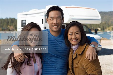 Parents and teenage daughter outside of RV Stock Photo - Premium Royalty-Free, Image code: 693-06014003