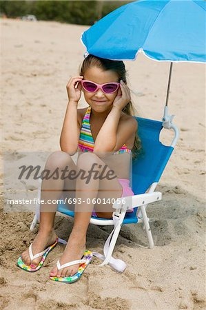 Little Girl on Beach Stock Photo - Premium Royalty-Free, Image code: 693-06014056