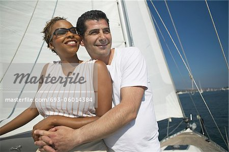 Affectionate Couple Relaxing on Yacht Stock Photo - Premium Royalty-Free, Image code: 693-06014384