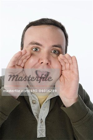 Portrait of mid-adult man shouting Stock Photo - Premium Royalty-Free, Image code: 693-06016289