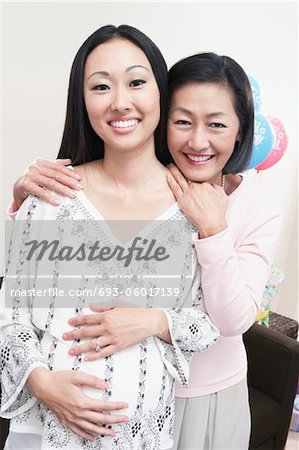 Mother and Daughter Enjoying a Baby Shower Stock Photo - Premium Royalty-Free, Image code: 693-06017139