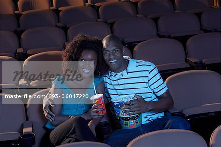 Couple Watching Movie Stock Photo - Premium Royalty-Free, Image code: 693-06017220