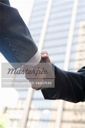Close-up of businessmen handshake, outdoors Stock Photo - Premium Royalty-Free, Image code: 693-06017530