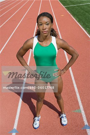 Female athlete ready to run, high angle view Stock Photo - Premium Royalty-Free, Image code: 693-06017748