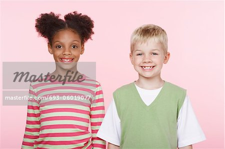 Smiling Girl and Boy Side by Side Stock Photo - Premium Royalty-Free, Image code: 693-06019077