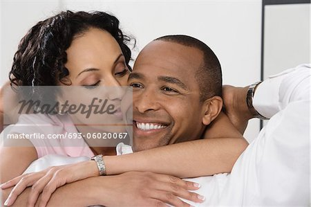 Woman Kissing Smiling Man Stock Photo - Premium Royalty-Free, Image code: 693-06020067