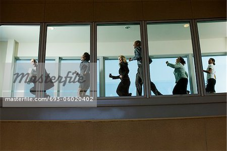 Businesspeople Running down Hallway Stock Photo - Premium Royalty-Free, Image code: 693-06020402