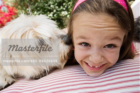 Little Girl with Her Pet Dog Stock Photo - Premium Royalty-Free, Image code: 693-06020639