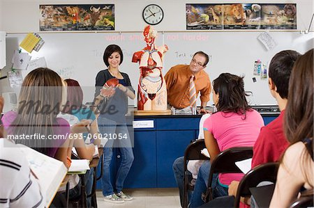 Student Giving Presentation in Science Class Stock Photo - Premium Royalty-Free, Image code: 693-06021054
