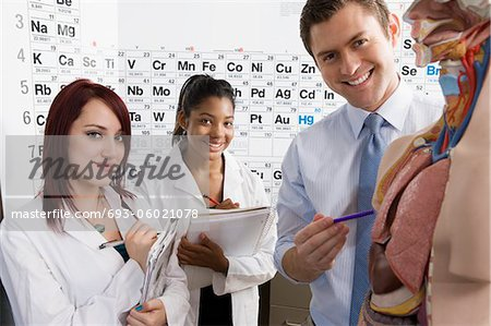 Teacher Giving Anatomy Lesson Stock Photo - Premium Royalty-Free, Image code: 693-06021078