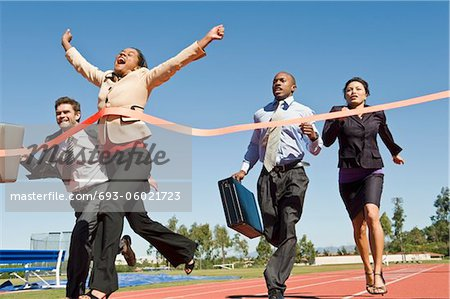 Business People Crossing the Winning Line Stock Photo - Premium Royalty-Free, Image code: 693-06021723