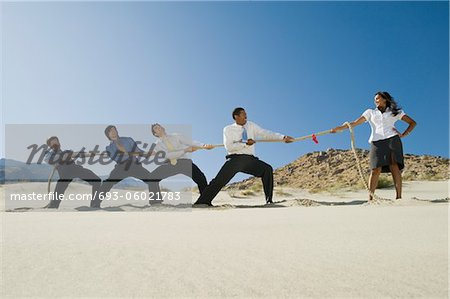Business People Playing Tug of war in the Desert Stock Photo - Premium Royalty-Free, Image code: 693-06021783