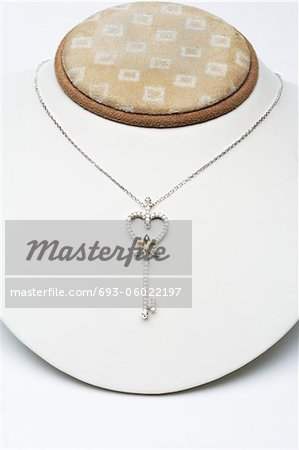 18k white gold key pendant with 0.50 carat diamonds Stock Photo - Premium Royalty-Free, Image code: 693-06022197