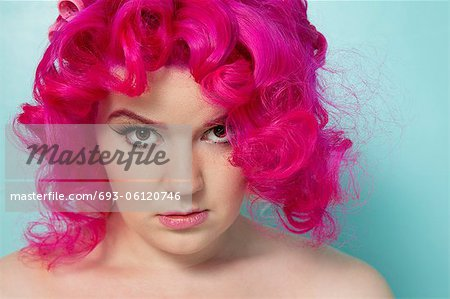 Portrait of a pink hair woman over colored background Stock Photo - Premium Royalty-Free, Image code: 693-06120746