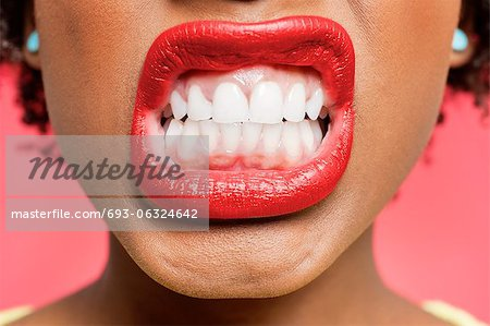 Detail shot of woman clenching teeth Stock Photo - Premium Royalty-Free, Image code: 693-06324642