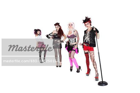 Portrait of beautiful all female band with microphone over white background