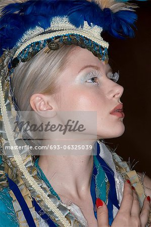 Side view fashion model wearing headgear looking away Stock Photo - Premium Royalty-Free, Image code: 693-06325039