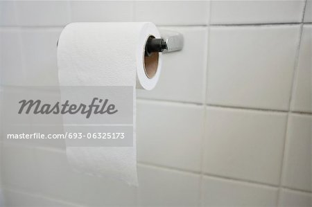 Close-up of tissue paper roll in bathroom Stock Photo - Premium Royalty-Free, Image code: 693-06325173