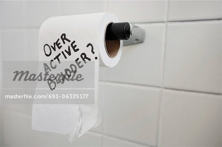 Close-up of toilet paper roll with text asking about bladder issues Stock Photo - Premium Royalty-Free, Image code: 693-06325177