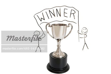 Trophy over stick figure drawing on whiteboard Stock Photo - Premium Royalty-Free, Image code: 693-06325182
