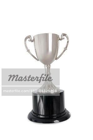 Winning trophy over white background Stock Photo - Premium Royalty-Free, Image code: 693-06325208