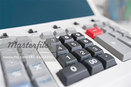 Close-up of calculator Stock Photo - Premium Royalty-Free, Image code: 693-06325226