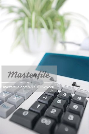 Close-up of calculator in office Stock Photo - Premium Royalty-Free, Image code: 693-06325228