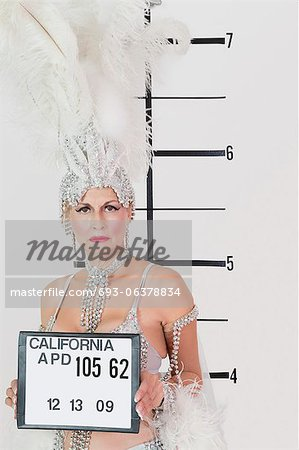 Mug shot of senior showgirl holding plaque Stock Photo - Premium Royalty-Free, Image code: 693-06378834
