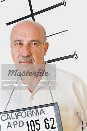 Mug shot of senior man Stock Photo - Premium Royalty-Free, Image code: 693-06378940